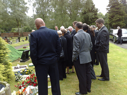 A picture of family/friends mourning at a traditional funeral