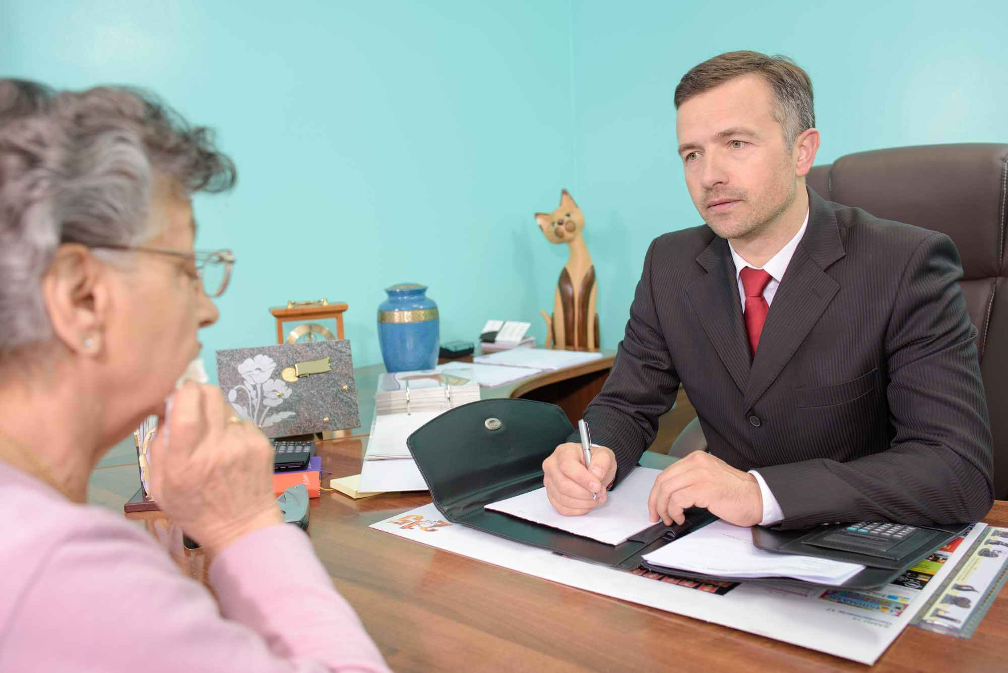funeral director discussing funeral costs with an elderly woman